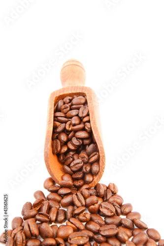 Wooden shovel filled of coffee beans