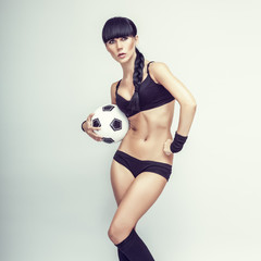 sporty young woman with a ball