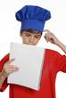 Niño chef leyendo receta,cocinero menú.