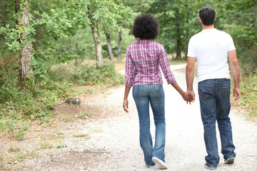 Couple walking in a forest
