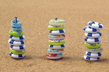 Stacks of inflatable rings on the beach, Qingdao, China
