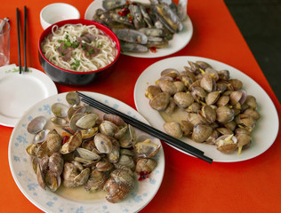 Fresh clams with chili in local seafood restaurant, China