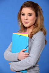 Student holding files