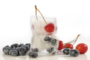 Fruits berries in ice cubes abstract concept
