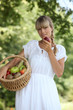 Summery woman with a basket of fruit
