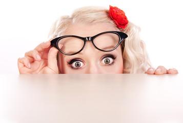 Funny girl hiding behind a table