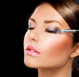 Make-up applying. Eye shadow brush