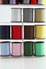 Stacked spools of thread.