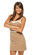Smiling female in beige dress standing with folded hands