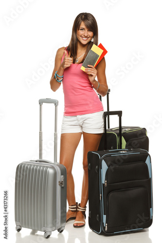 Full length of female with travel bags, passport and tickets