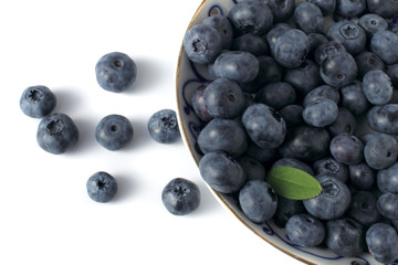 blueberries on porcelain plate isolated on white