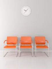 A wall clock and 3 orange chairs in the waiting room