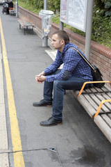 Young man waiting train