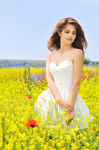 girl wearing white dress in the field