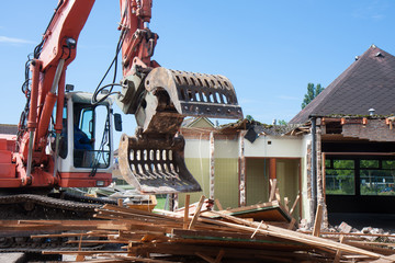 Demolition of a building with a excavator