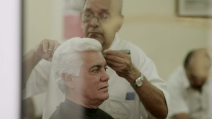 Beauty, senior man cutting hair to client in old barber shop
