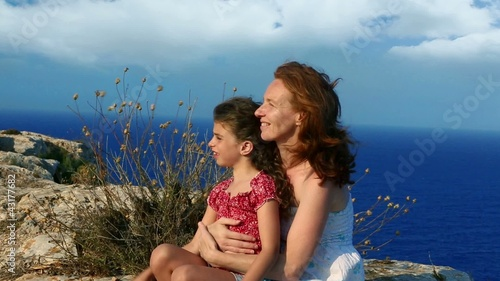 Family happy smiling  in cliff blue sea background