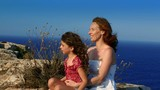Family happy greeting goodbye in blue sea background