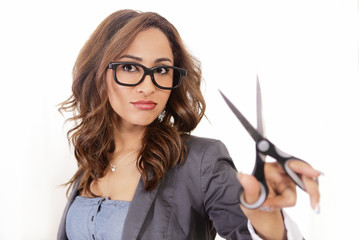 Cost cutting businesswoman holding symbolic scissor