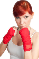 Red-haired female fighter standing in defensive position