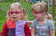Two Toddler Girls Wearing Sunglasses Outside Playing