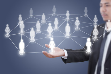 Businessman Holding Social Network diagram.