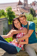 Young happy couple embracing on balcony smiling