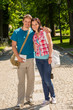 Young man and woman tourist smiling