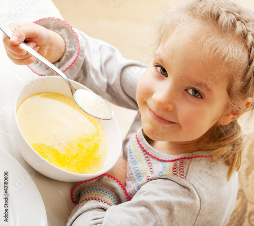 Little girl eating soup