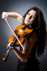 Female violin player against background