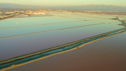 Aerial view of salt water ponds in natural wetlands