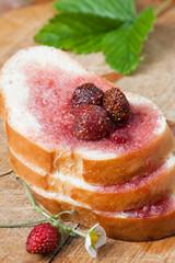 Fresh bread with strawberry jam