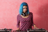 Punk girl DJ with dyed blue hair poster