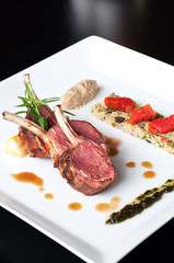 Australian lamb roasted with herbs , couscous and mutabbel