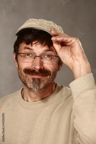 man with baseball cap greeting friendly