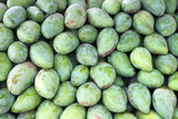 Piles of raw mangoes