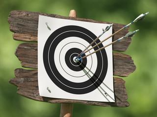 Three arrows on an archery target