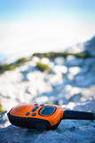 Closeup of a walkie-talkie laid aside on a rock  poster