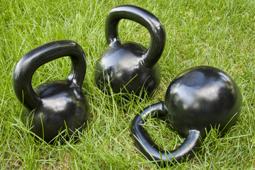 heavy kettlebells in grass