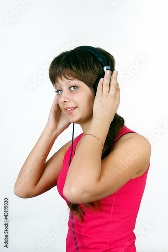 attractive young girl listening to music