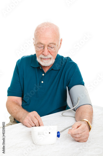 Senior Man Takes His Blood Pressure