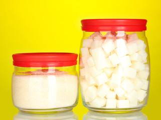 Jars with white lump sugar and white crystal sugar