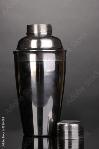 Cocktail shaker on grey background