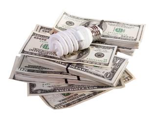 light bulb on dollars. Isolated on white