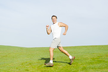 happy smiling man running.