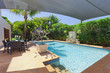 Backyard with swimming pool - 43202832