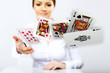 Young woman showing poker cards