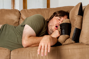 Man taking a quick nap on the couch