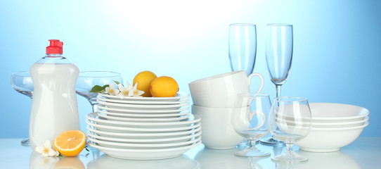 empty clean plates, glasses and cups with dishwashing liquidand