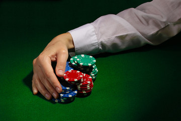 Taking win in poker on green table